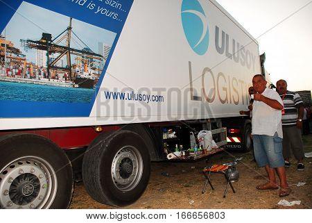 ANKARA, TURKEY - JULY 22, 2011 : Ulusoy Logistics Company's staff beside the semi-trailer truck for Turkish Coffee break in Ankara, Turkey.