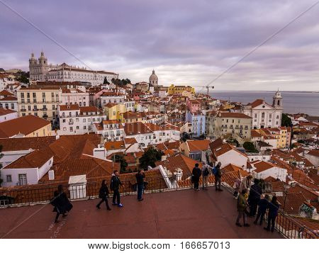 LISBON PORTUGAL - JANUARY 10 2017: Cityscape of Lisbon Portugal seen from Portas do Sol at sunset.