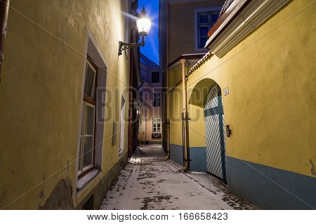 TALLINN ESTONIA - 4TH JAN 2017: Old streets of Tallinn at dawn along Toompea Hill. The outside of buildings can be seen.