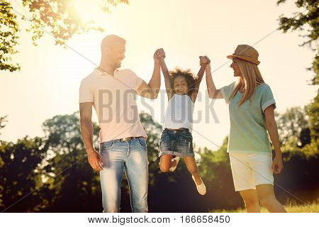 Playful Family Having Fun Outdoors