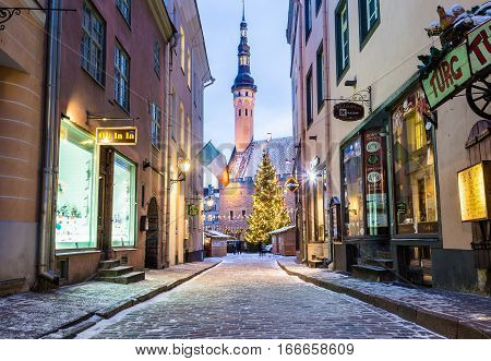TALLINN ESTONIA - 4TH JAN 2017: Raekoja plats Old Town Hall Square in Tallinn in the morning during the festive period. Christmas decorations market stalls and people can be seen.