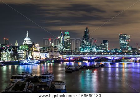 Part of the London Skyline at night showing buildings in central London and the River Thames