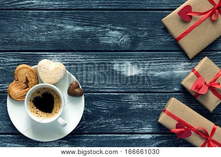 Valentines Day Concept Wrapped Gifts Coffee With Candies On Wood
