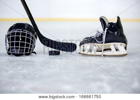 Hockey Helmet, Puck, Stick and Skate on Hockey Rink