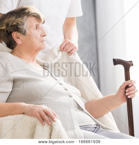 Senior Woman With A Walking Stick