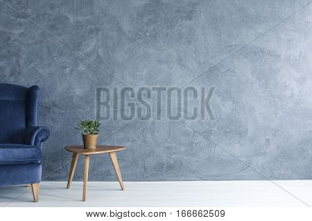 Blue Armchair And Wood Side Table