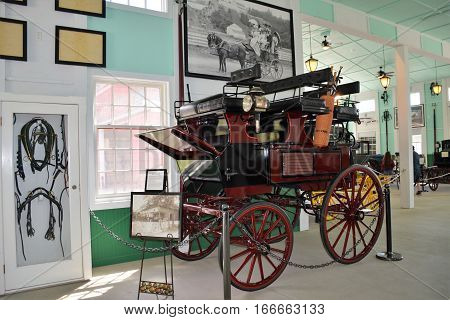 MACKINAC ISLAND, MI - JULY, 2016:  Vintage carriages with their history and photos are on display inside the carriage museum.
