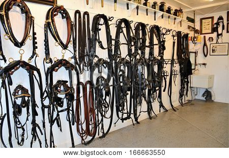MACKINAC ISLAND, MI - JULY 2016: Bridal equipment is on display in the tack room of the vintage carriage museum.
