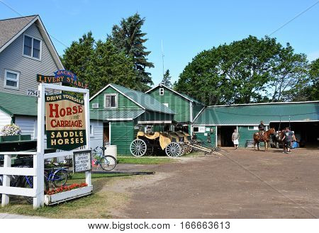 MACKINAC ISLAND, MI. - JULY, 2016: Buggy or horse rental is a popular activity for tourists on the island.