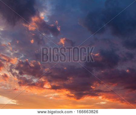 Fiery vivid colorful sunset sky clouds scape