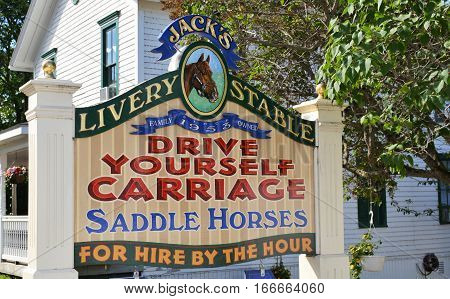 MACKINAC ISLAND - JULY 2016: Renting a horse and carriage is a popular activity for tourists.