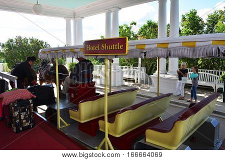 MACKINAC ISLAND - JULY, 2016: A horse drawn hotel shuttle picking up passengers at the Grand Hotel.