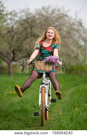 Girl With Vintage White Bicycle With Flowers Basket