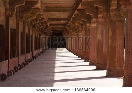 Long sandstone colonnade in Fatehpur Sikri Agra India.