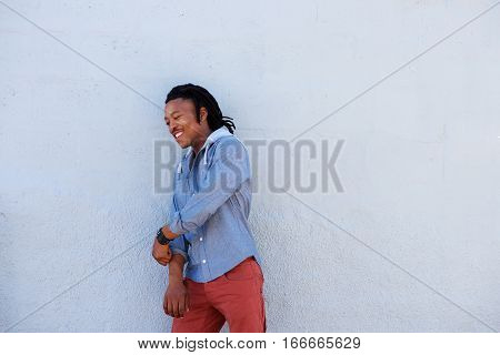 African Man With Dreadlocks Smiling Against Gray Background