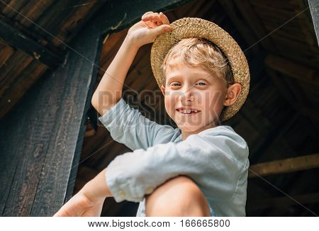 Carefree country boy in straw hat .