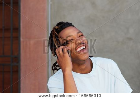 Cool African Guy  Laughing And Talking On Cellphone