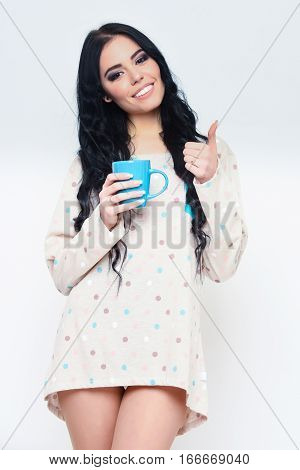 Smiling Pretty Sexy Girl With Coffee Cup Isolated On White