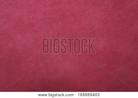 Crimson pink leather texture closeup background. Structured background design nubuk