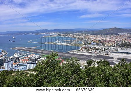 View of the Gibraltar International Airport and the harbor area with the spanish town of La Línea de la Concepción.