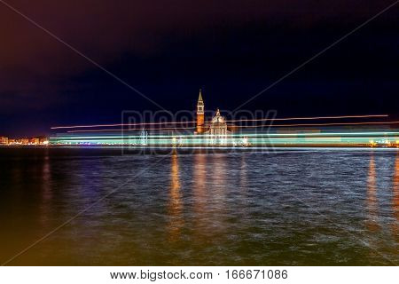 View of the Church of San Giorgio Maggiore on the island in the Venetian lagoon at night.
