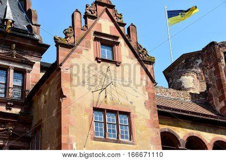 Sundial at Castle Heidelberg Germany and flag