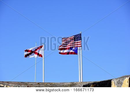 The American Flag the Flag of Puerto Rico and the Cross of Burgundy flag.
