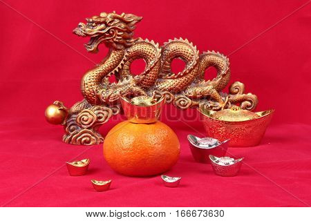 Golden Orange With Golden Dragon And Silver Celebrate The Blessing.
