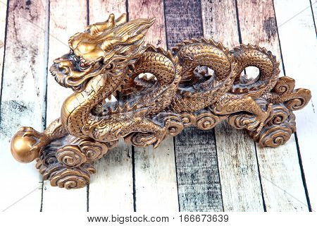 Golden Dragon Statue On Wood ,to Celebrate For Chinese Festival.