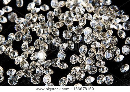 Faceted diamonds on a dark background .