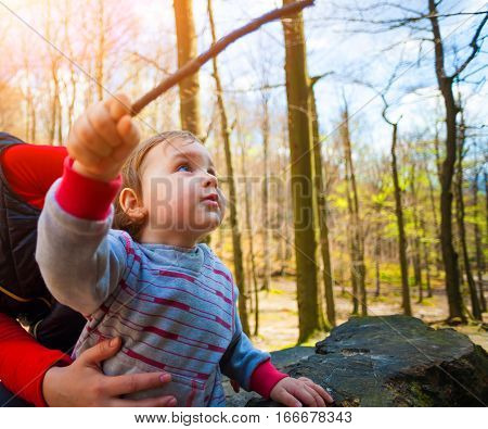 Little Boy Plays With A Wooden Stick.