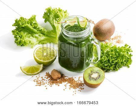 Blended smoothie with ingredients ( lime kale almond flax kiwi) in a jar mug isolates on white background.