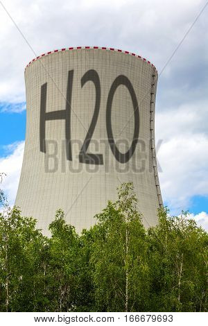 Cooling tower of nuclear power plant with the inscription H2O