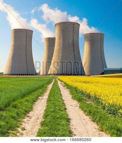 Nuclear power plant Dukovany with rape field, Czech Republic