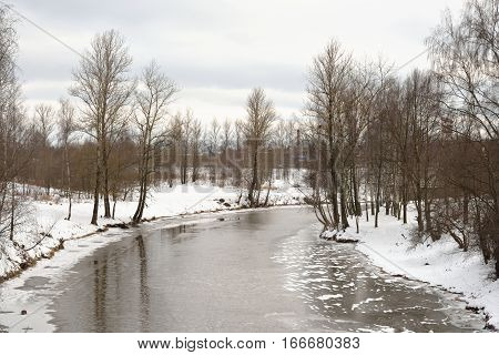 View of Slavyanka River on the outskirts of St. Petersburg at cloud winter day Russia. poster