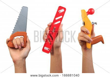 Engineer tool toy concept. Boy hand holding saw tool, water level tool and carpenter plane tool toy isolated on white background with blank space.