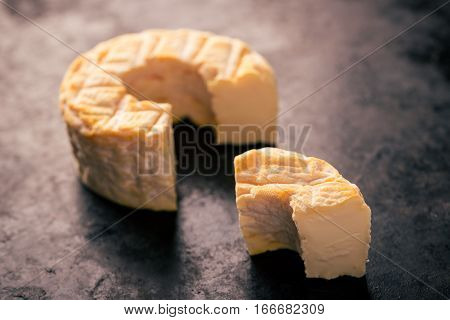 Portion Cut From Whole Camembert Cheese With Orange Color