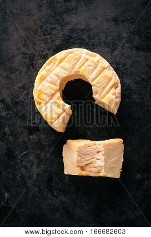 Top View On Portion Cut From Whole Golden Camembert Cheese