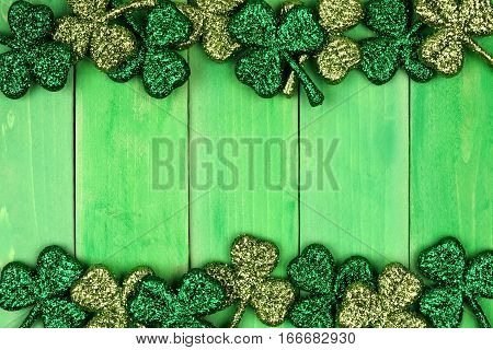 St Patricks Day Double Border Of Shiny Glitter Shamrocks Over A Green Wood Background