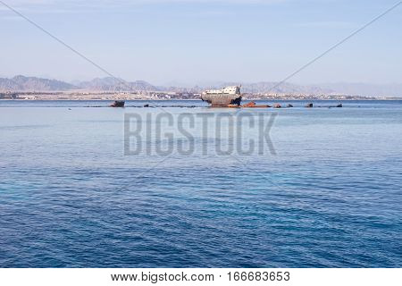 Egypt sea and mountains landscape with shipwreck