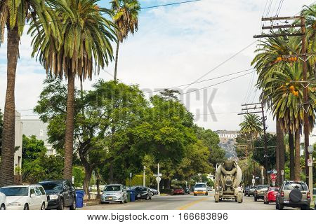 LOS ANGELES CALIFORNIA - OCTOBER 28 2016:Hollywood sign with palm trees in the foreground California