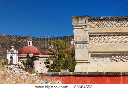 Mayan city ruins in Mitla near Oaxaca city. The most important of the Zapotec religious centers. In the background San Pablo church