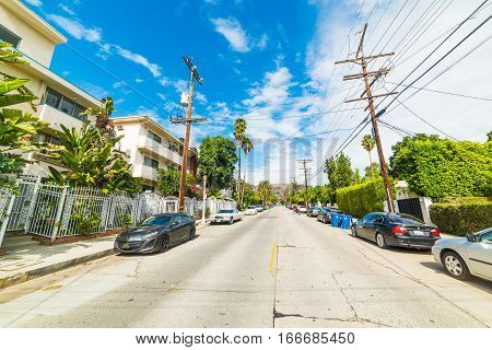 LOS ANGELES CALIFORNIA - OCTOBER 28 2016: Hollywood sign seen from a picturesque street