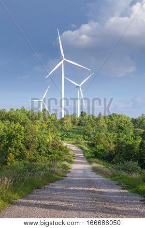 Close up of wind turbines in blue sky