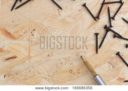 Screws On The Osb Plank Top View. Isolated Background With Copy Space. Concept For Construction, Rep