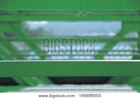 Background green steel construction partly out of focus