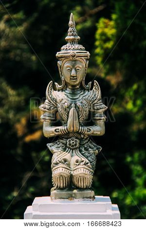 Emerald Colored Praying Woman Sculpture in Northern Thailand