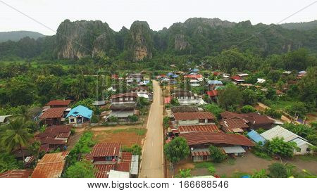 Village with limestone mountain at Noen Maprang in Thailand