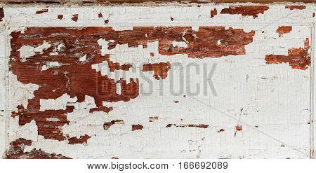 Old wooden brown textured background with peeling paint white brown color. Vintage backdrop for various designs