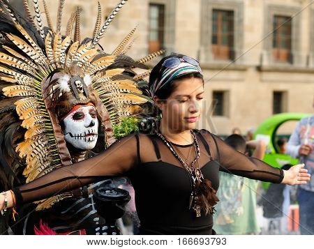 MEXICO MEXICO - FEBRUARY 16: Aztec sorcerer sending old ceremonies away on city dwellers of Mexico on February 16 2013